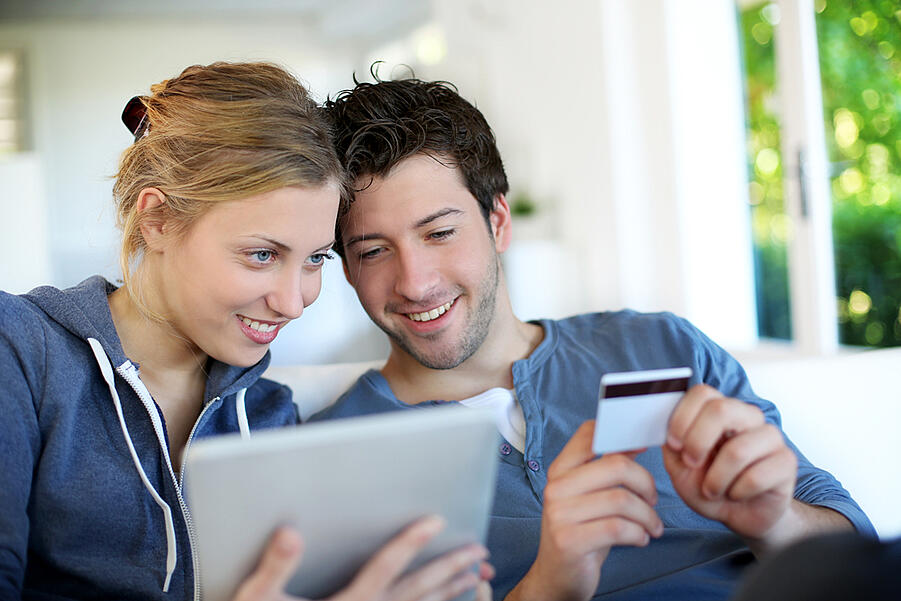 Happy young couple doing shopping on internet