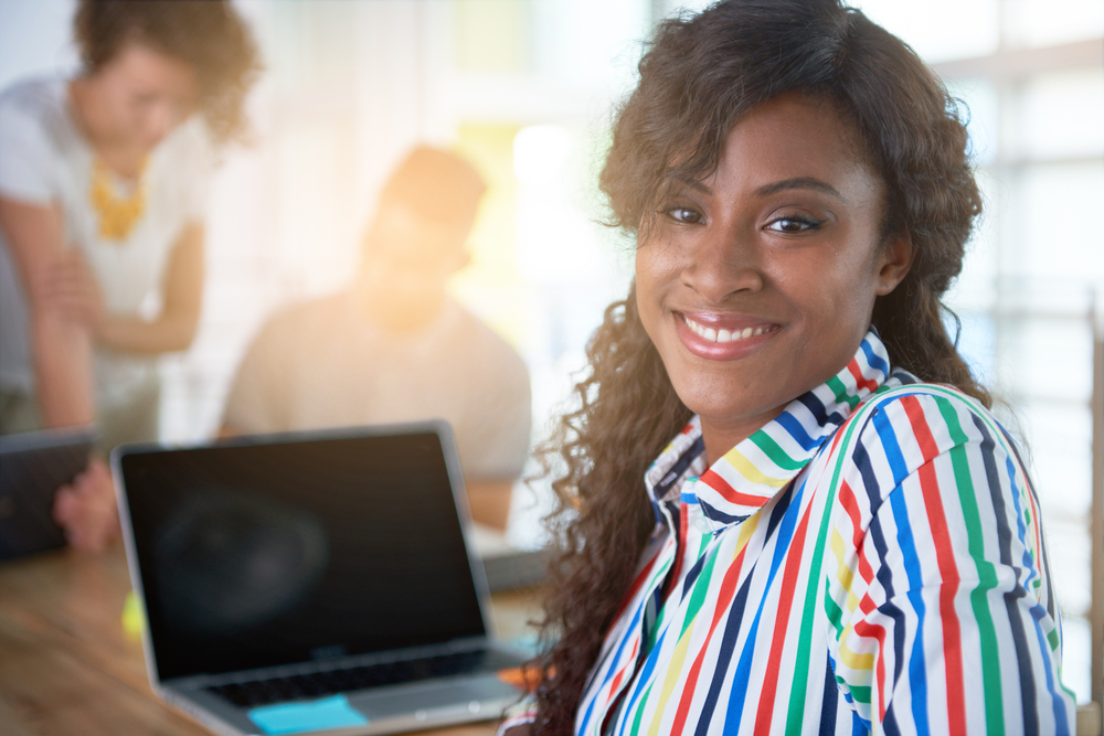 Image of a succesful casual business woman using laptop during meeting-3
