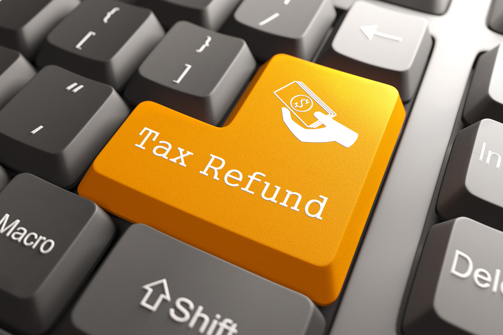 Tax Refund - Orange Button. Tax return thoughts for Minnesota small businesses.