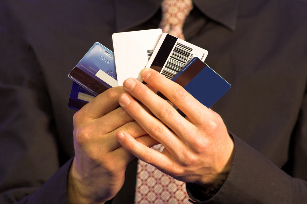 business man holding credit cards