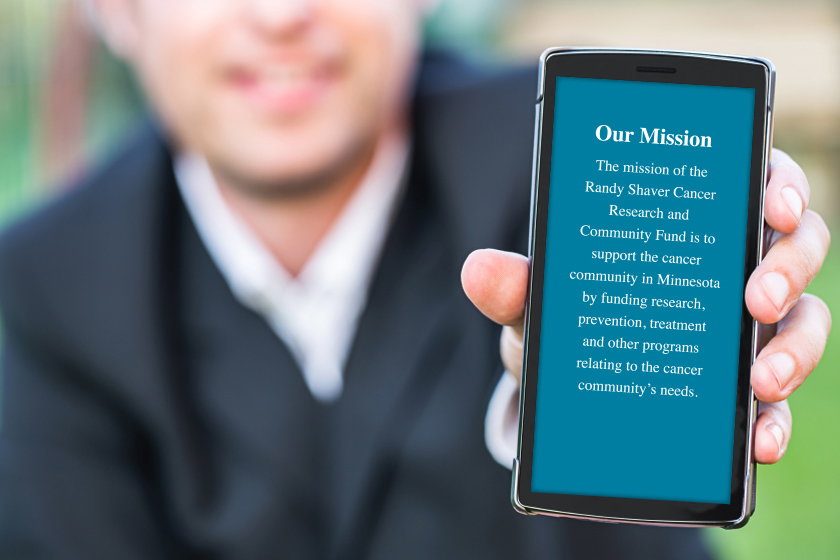 man-holding-mobile-phone-with-randy-shaver-mission-statement