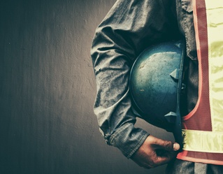construction worker holding hard hat